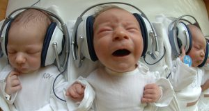 One and Two-day-old newborn babies listen to music with headphones at the 1st Private Hospital in eastern Slovak metropol of Kosice-Saca 11 August 2005. The experimental program that started approximetly two years ago, is based on using musical therapy in improving the quality of carring for the newborns shortly after the birth.This project helps to stimulate the communication, adaptation and ease the stress after the birth. Presently there are thirty newborn babies daily undergoing five sessions of twenty minutes each, when they listen to a variety of musical genres from classical to easy listening. AFP PHOTO JOE KLAMAR